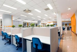 orange white and blue office with cubicles